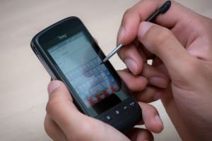 An HTC Touch2 being operated with a stylus.